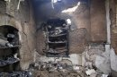 Burnt rooms inside a prison are seen following a Taliban attack in Dera Ismail Khan