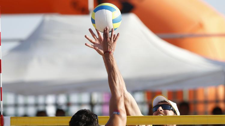 Brazil's Conte and Chile's Grimalt dispute a ball during their men's gold medal volleyball beach match during the South American Games (ODESUR) in Santiago