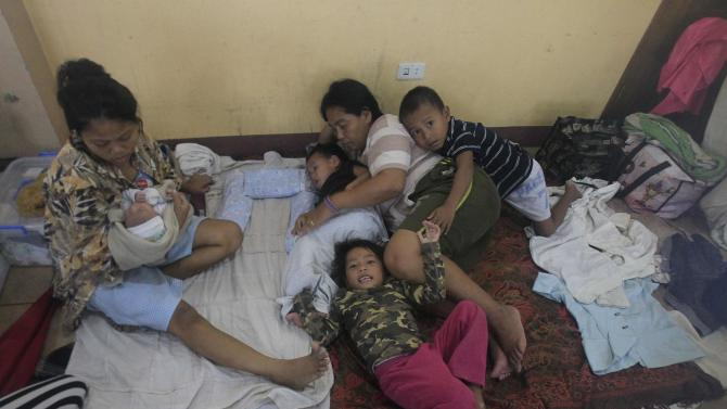 Flood victims take a rest inside a evacuation center after tropical storm Fung-Wong battered metro Manila