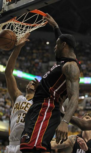 James, Wade combine for 70 as Heat win Game 4