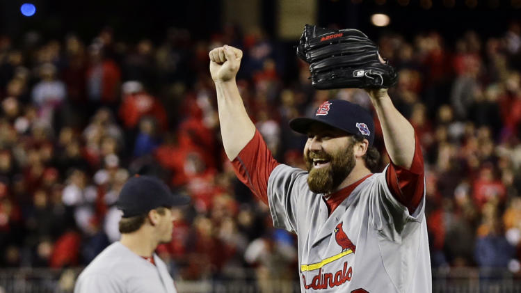 St. Louis Cardinals relief pitcher Jason Motte, front, and third baseman David Freese react after Game 5 of the National League division baseball series against the Washington Nationals on Saturday, Oct 13, 2012, in Washington. St. Louis won 9-7. (AP Photo/Alex Brandon)