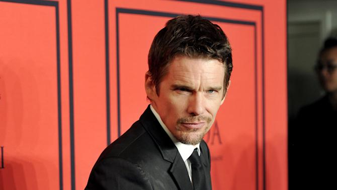 "FILE - This June 3, 2013 photo shows actor Ethan Hawke at the 2013 CFDA Fashion Awards at Alice Tully Hall in New York. Hawke will star in the Lincoln Center Theater production of ""Macbeth,"" beginning performances on Thursday, October 24 in the Vivian Beaumont Theater in New York. (Photo by Evan Agostini/Invision/AP, file)"