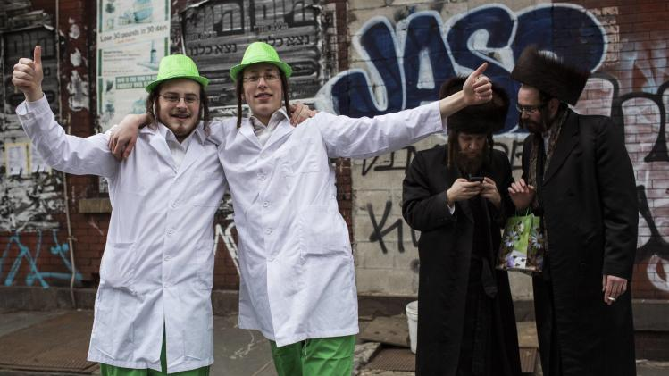 Men dance on the street during the Jewish holiday of Purim in the South Williamsburg suburb of New York