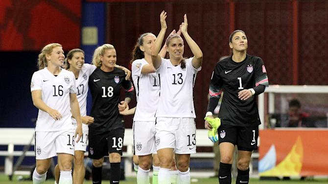 Alex Morgan (C) and Hope Solo (R) of the US celebrate with teammates their 2-0 victory against Germany, during the FIFA Women's World Cup, at Olympic Stadium in Montreal, Canada, on June 30, 2015
