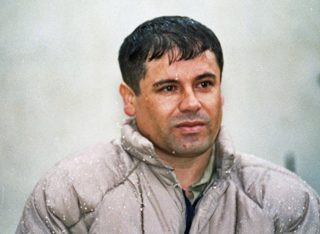 FILE - In this June 10, 1993 file photo, Joaquin Guzman Loera, alias &quot;El Chapo&quot; Guzman, is shown to the media after his arrest at the high security prison of Almoloya de Juarez, on the outskirts of Mexico City. Guatemalan authorities say on Thursday, Feb. 21, 2013, they are investigating whether a man killed in a shootout near the border with Mexico is most-wanted drug lord Joaquin &quot;El Chapo&quot; Guzman. (AP Photo/Damian Dovarganes, File)