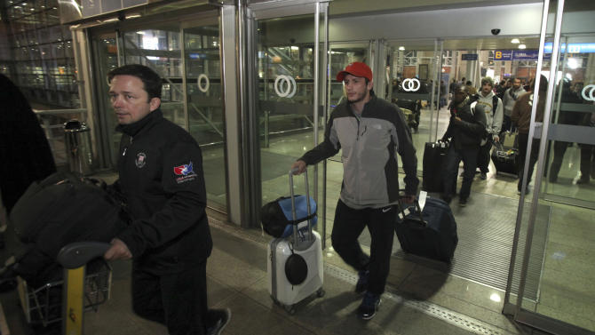 U.S. National freestyle wrestling coach Zeke Jones, left, arrives with his team at the Imam Khomeini airport in Tehran, Iran, early Tuesday morning, Feb. 19, 2013, to attend World Cup tournament. USA Wrestling has formalized plans for a committee charged with restoring Olympic wrestling. (AP Photo/Vahid Salemi)