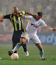 Marseille's Joey Barton (R) clashes for the ball with Fenerbahce's Alex de Souza during their UEFA Europa League match at Sukru Saracoglu Stadium in Istanbul. The match ended in a 2-2 draw