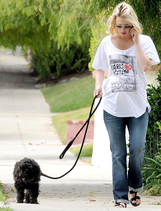 Celebrity pets: January Jones goes for a stroll with her four-legged friend.