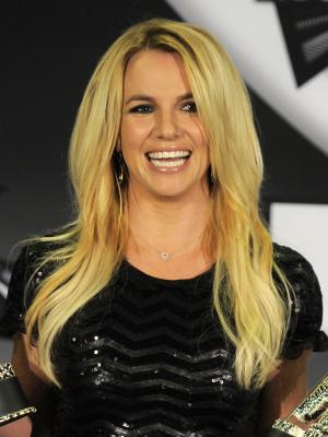 FILE - In this Aug. 28, 2011 file photo, Britney Spears poses backstage at the MTV Video Music Awards in Los Angeles. A Los Angeles judge on Tuesday blocked efforts by a company suing the singer to gain access to sealed medical records that were used to prohibit Spears from being deposed. (AP Photo/Chris Pizzello, file)