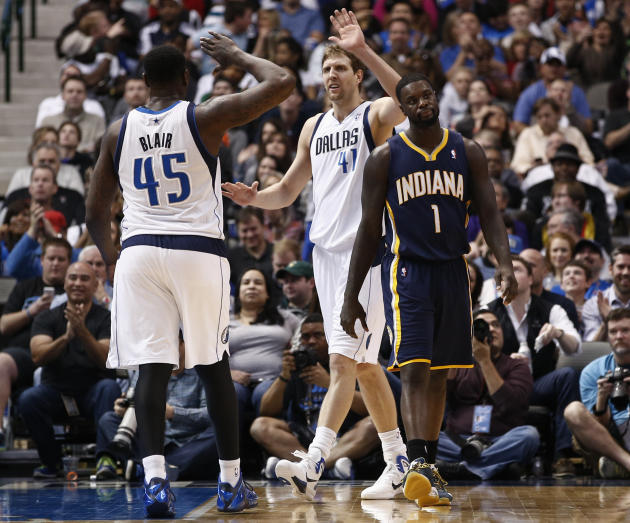 Dallas Mavericks power forward Dirk Nowitzki (41) of Germany celebrates with center DeJuan Blair (45) after drawing a foul by Indiana Pacers' Lance Stephenson (1) during the second half of an NBA