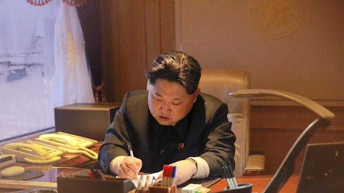 File photo shows North Korean leader Kim Jong Un signing a document in Pyongyang
