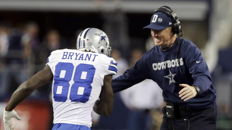 Dallas Cowboys wide receiver Dez Bryant (88) celebrates his touchdown against the Pittsburgh Steelers with Dallas Cowboys head coach Jason Garrett during the second half of an NFL football game Sunday, Dec. 16, 2012 in Arlington, Texas. (AP Photo/Tony Gutierrez)