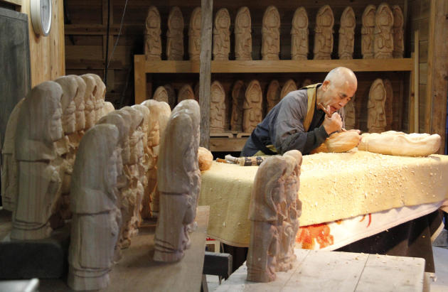 "Seitaiji Temple's Buddhist priest Yasuhiro Koike, 72, carves a statue of ""kannon,"" the goddess of mercy, in Higashimatsuyama city, Miyagi prefecture, northern Japan, Saturday, March 8, 2014"