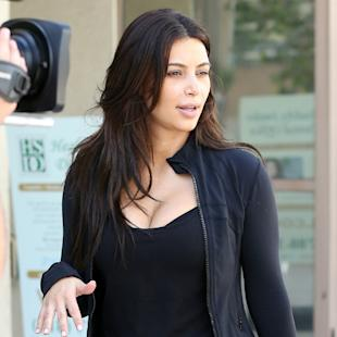 Kim Kardashian Flaunts Impressive Booty In All Black As She Gets Sweaty For 'Keeping Up With The Kardashians' (PHOTOS)