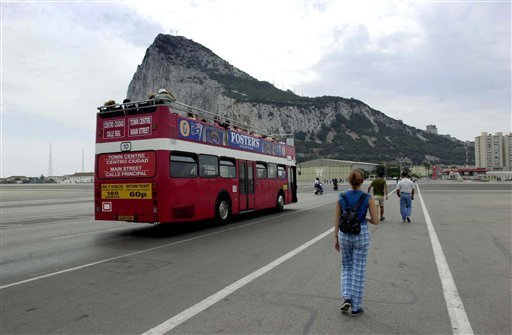 In this Aug. 26, 2001 file photo, tourists walk and take a bus from the Spanish border into Gibraltar. Gibraltar has been accepted as a full member by the UEFA Congress, becoming Europe's 54th officia