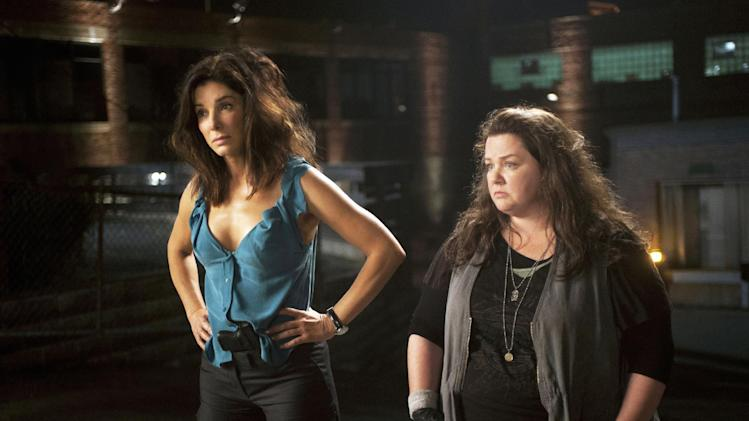 "This publicity photo released by Twentieth Century Fox shows Sandra Bullock, left, as FBI Special Agent Sarah Ashburn, and Melissa McCarthy, as Boston Detective Shannon Mullins, in a scene from the film, ""The Heat."" The movie releases June 28, 2013. (AP Photo/Twentieth Century Fox, Gemma La Mana)"