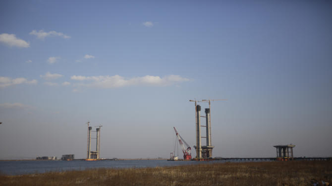 In this Feb. 6, 2013 photo, an unfinished bridge linking China and North Korea, is seen in Dandong, China, opposite the North Korean border town of Sinuiju. China's patience with North Korea is wearing thin, and a widely-expected nuclear weapons test by the latter could bring that frustration to a head. Beijing signaled its growing unhappiness by agreeing to tightened U.N. sanctions after North Korea launched a rocket in December, eliciting harsh criticism from Pyongyang and comment from China watchers surprised by Beijing's unusually tough line. (AP Photo/Eugene Hoshiko)