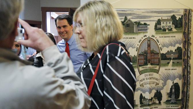 Potential Republican 2016 presidential candidate Wisconsin Governor Scott Walker poses for a photograph after speaking to local activists and elected officials in Derry