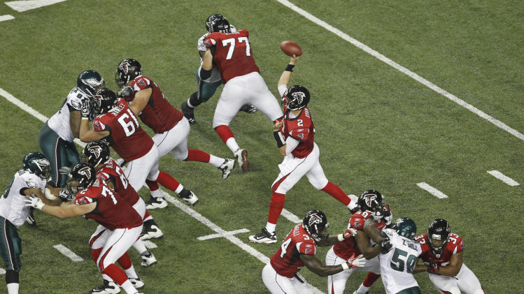 Atlanta Falcons quarterback Matt Ryan (2) looks for a receiver in the second half of an NFL football game against the Philadelphia Eagles at the Georgia Dome in Atlanta on Sunday, Sept. 18, 2011. (AP Photo/Butch Dill)