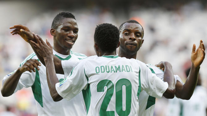 Nigeria's Nnamdi Oduamadi is celebrated after scoring his side's 3rd goal by Sunday Mba, right, and Kenneth Omeruo during the soccer Confederations Cup group B match between Tahiti and Nigeria in Belo Horizonte, Brazil, Monday, June 17, 2013. (AP Photo/Bruno Magalhaes)