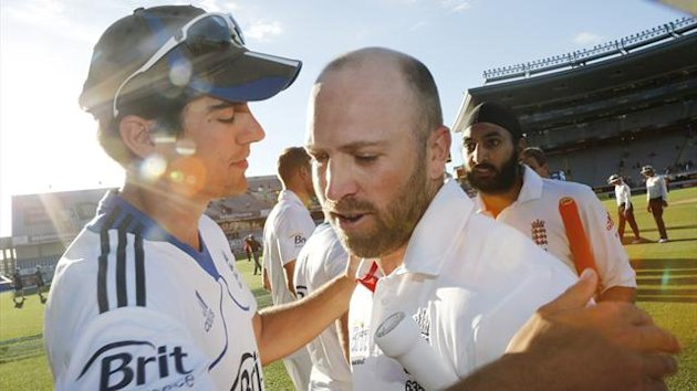 Captain Alastair Cook embraces Matt Prior