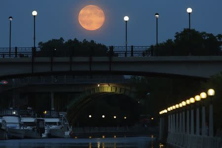 A Supermoon is seen over the Rideau Canal in Ottawa