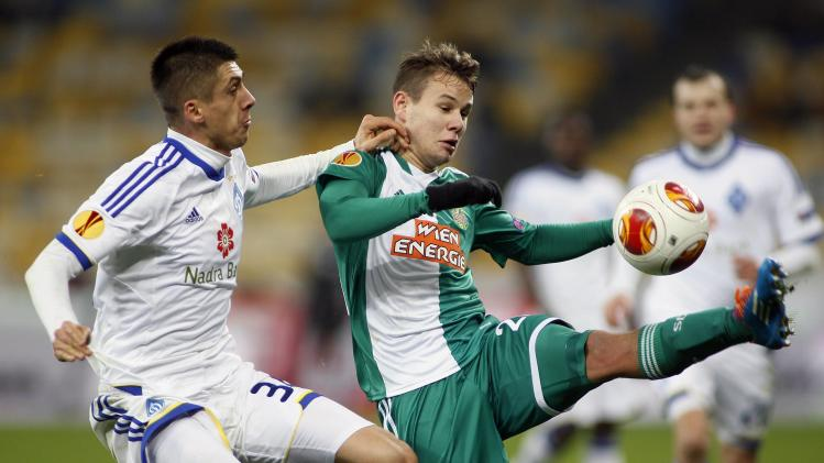 Dynamo Kiev's Khacheridi fights for the ball with Rapid Vienna's Schaub during their Europa League soccer match in Kiev