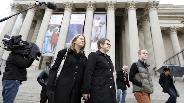Sandy Stier, left, and Kris Perry of Berkeley, Calif., arrive at the National Archives in Washington, Monday, March 25, 2013, to view the U.S. Constitution, a day before their same-sex marriage case is heard before the Supreme Court. (AP Photo/Jose Luis Magana)