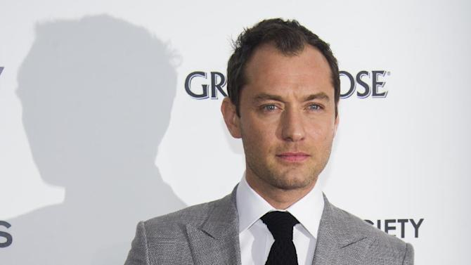 """Jude Law attends the premiere of """"Side Effects"""" hosted by the Cinema Society and Open Road Films on Thursday, Jan. 31, 2013 in New York. (Photo by Charles Sykes/Invision/AP)"""