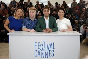 """Director Xavier Dolan, cast members Suzanne Clement, Antoine-Olivier Pilon and Anne Dorval pose during a photocall for the film """"Mommy"""" in competition at the 67th Cannes Film Festival in Cannes"""