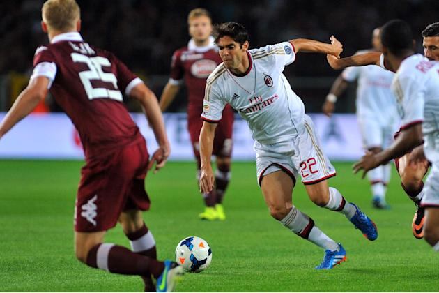In this Saturday, Sept. 14, 2013 file photo AC Milan Ricardo Kaka, of Brazil, center, controls the ball past Torino's Kamil Glik, of Poland, during a Serie A soccer match at the Olympic stadium, in Tu