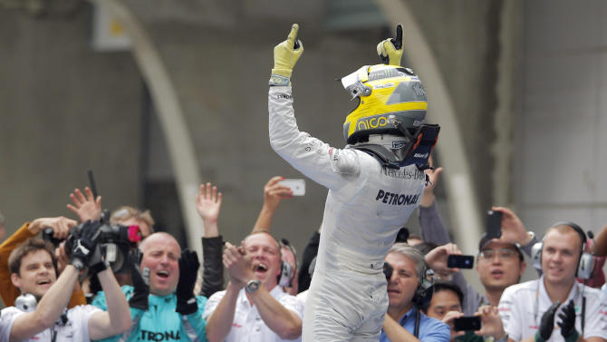 Mercedes Formula One driver Nico Rosberg of Germany celebrates after winning the Chinese Grand Prix in Shanghai, Sunday, April 15, 2012.  (AP Photo/Greg Baker)