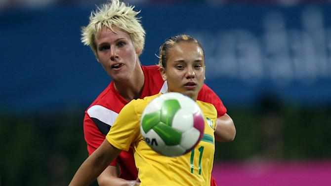 Brazil's Thais Guedes, front, is challenged by Canada's Sophie Schmid during a women's soccer gold medal match at the Pan American Games in Guadalajara, Mexico, Thursday, Oct. 27, 2011. (AP Photo/Juan Karita)