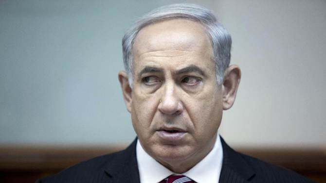 Israeli Prime Minister Benjamin Netanyahu attends the weekly cabinet meeting in his office in Jerusalem, Israel, June 9, 2013. A senior member of Prime Minister Benjamin Netanyahu's Likud Party said in an interview broadcast Sunday that the Israeli government will not accept a Palestinian state with the borders favored by the Palestinians and the international community, a new hurdle to U.S. Secretary of State John Kerry's effort to restart peace talks in his latest visit to the region. Netanyahu's office has tried to distance itself from the comments. (AP Photo/Abir Sultan, Pool)