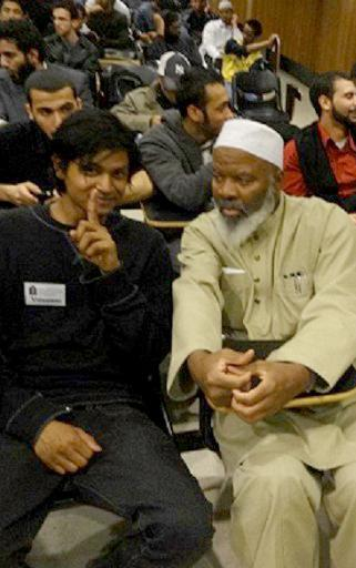 This handout photo provided by Jamill Noorata, taken May 3, 2012, shows Shamiur Rahman, left, sitting with Siraj Wahhaj at John Jay College of Criminal Justice in Manhattan, New York. The New York Police Department defends its surveillance of Muslims as narrowly focused in a new court filing in a civil rights lawsuit. But text messages between a detective and an informant obtained by The Associated Press reveal wide-ranging efforts to get Muslims to privately make incriminating statements about jihad. By Matt Apuzzo and Adam Goldman.  (AP Photo/Courtesy of Jamill Noorata)
