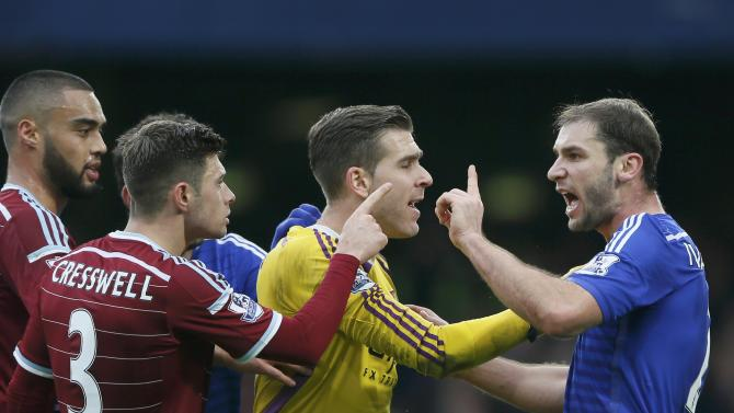 Chelsea's Branislav Ivanovic argues with West Ham United's Adrian and Aaron Cresswell during their English Premier League soccer match at Stamford Bridge in London