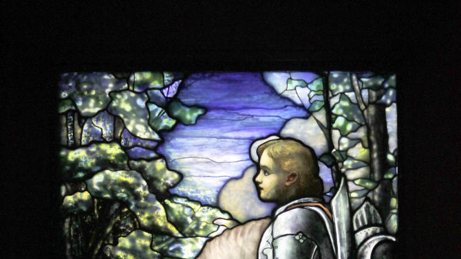 """In this Thursday, Oct. 25 2012 photo, Sir Galahad, Cryder Memorial Window, from St. Andrew's Dune Church, Southampton, N.Y., appears on display at the """"Louis C. Tiffany and the Art of Devotion"""" exhibit at the Museum of Biblical Art in New York.  (AP Photo/Mary Altaffer)"""