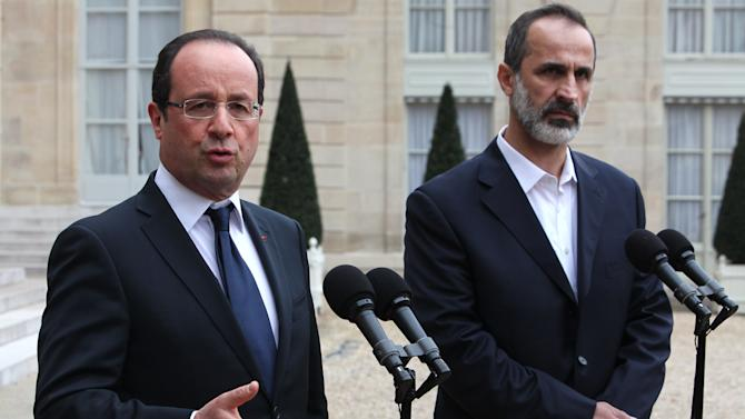 French President Francois Hollande, left, and head of the new Syrian National Coalition for Opposition and Revolutionary Forces Mouaz al-Khatib, right, give a press conference after a meeting, at the Elysee Palace, in Paris, Saturday, Nov. 17, 2012. French President Francois Hollande and the new Syrian opposition leader have announced plans to install a new ambassador to represent Syria in France. The announcement came after talks Saturday at the presidential palace in Paris between Hollande and Moaz al-Khatib, head of the newly formed Syrian opposition coalition. France is the only Western country to have formally recognized the group as the representative of the Syrian people. (AP Photo/Thibault Camus)