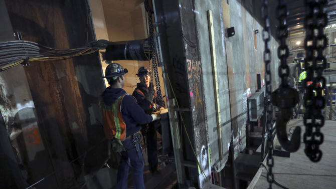 In this Wednesday, Jan. 23 2013 photo, contractors work at the Second Avenue Subway construction project in New York. The Second Avenue Subway will eventually serve Manhattan's far East Side, from Harlem to the island's southern tip. (AP Photo/Mary Altaffer)