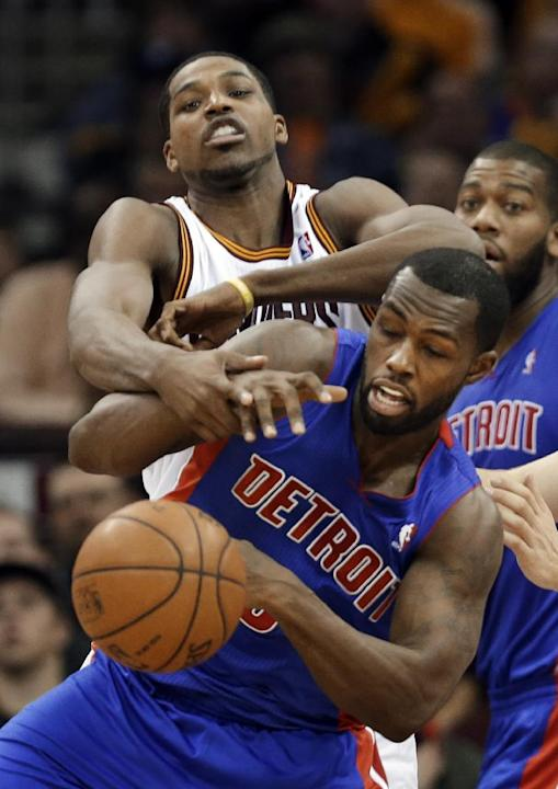 Cleveland Cavaliers' Tristan Thompson, top, fights for a rebound with Detroit Pistons' Rodney Stuckey during the fourth quarter of an NBA basketball game Monday, Dec. 23, 2013, in Cleveland. T