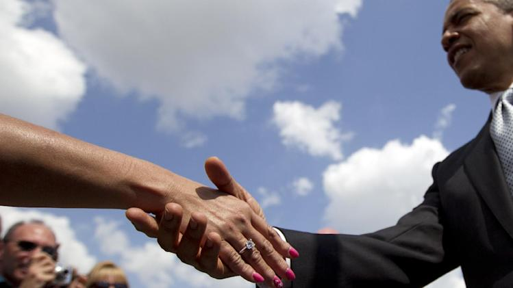 President Barack Obama shakes hands as he arrives at Palm Beach International Airport, Tuesday, April 10, 2012, in West Palm Beach, Fla. (AP Photo/Carolyn Kaster)