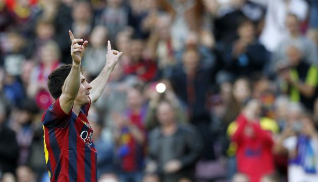 Barcelona's Lionel Messi celebrates his 370th goal for FC Barcelona, becoming the most prolific striker of the club, during the Spanish first division soccer match against Osasuna in Barcelona