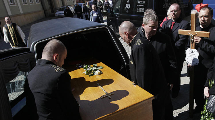 The wooden casket of Barbara Piasecka Johnson arrives for a funeral Mass at the Cathedral in Wroclaw, Poland, on Monday, April 15, 2013. A farmer's daughter, she came to The United State in 1968 and worked as a maid for an American heir to the Johnson & Johnson fortune before marrying him and eventually inheriting some $ 300 million of his wealth. An art collector and philanthropist, she died near Wroclaw on April 1. (AP Photo/Czarek Sokolowski)