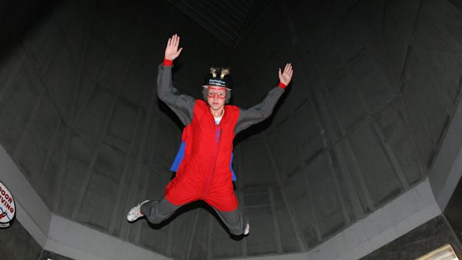 This Dec. 2012 photo provided by Jonathan Clark shows Iain Clark at an indoor skydiving center in Denver. Clark's mother, Dr. Laurel Clark, and six other astronauts, Commander Rick Husband, co-pilot William McCool, Kalpana Chawla, Michael Anderson, Dr. David Brown and Israeli Ilan Ramon, were killed in the final minutes of their 16-day scientific research mission aboard the space shuttle Columbia on Feb. 1, 2003. Iain is set to graduate this spring from a boarding school in Arizona; he wants to study marine biology at a university in Florida. (AP Photo/Jonathan Clark)