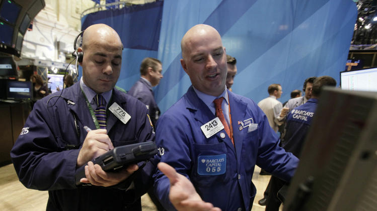 Trader Fred Demarco, left, and specilaist John O'Hara work on the floor of the New York Stock Exchange Monday, Nov. 28, 2011. Hopes for a more far-reaching solution to Europe's debt crisis and a strong start to the U.S. shopping season sent stocks sharply higher Monday. (AP Photo/Richard Drew)