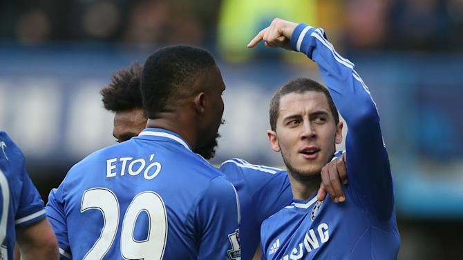 Chelsea's Eden Hazard, right, celebrates after scoring the opening goal and points towards teammate Samuel Eto'o who provided the assist during their English Premier League soccer match between Chelsea and Newcastle United in London Saturday, Feb 8 2014. (AP Photo/Alastair Grant)