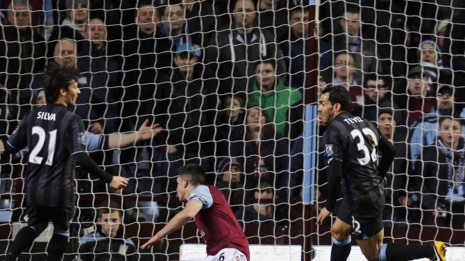 Manchester City's Carlos Tevez, right, runs to celebrate after scoring against Aston Villa during their English Premier League soccer match at the Villa Park ground in Birmingham, England, Monday, March 4, 2013. (AP Photo/Lefteris Pitarakis)