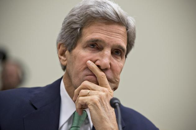 In this Dec. 10, 2013, photo, Secretary of State John Kerry testifies on Capitol Hill in Washington, before the House Foreign Affairs Committee. Continuing a furious pace of shuttle diplomacy aimed at