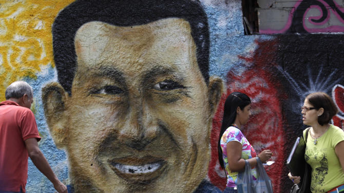 A mural of Venezuela's President Hugo Chavez decorates a wall in Caracas, Venezuela, Wednesday, Jan. 9, 2013.  Venezuela's congress has voted to postpone the inauguration of President Hugo Chavez, which was scheduled for Thursday, to let him recover from cancer surgery in Cuba. Critics say that violates the country's constitution. On Wednesday, Venezuela's Supreme Court backed the congress, ruling Chavez's inauguration can be postponed. (AP Photo/Ariana Cubillos)