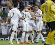 Real Madrid players celebrate after scoring during the Spanish league football match against Mallorcaon May 13. Mesut Ozil scored twice while Cristiano Ronaldo and Karim Benzema also hit the target during the match